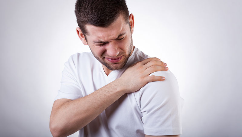 Man with frozen shoulder and shoulder pain