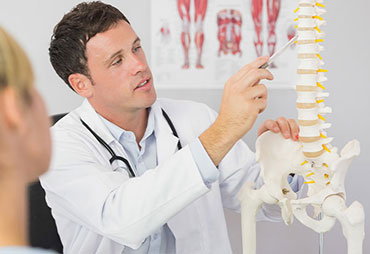 Chiropractor explaining chiropractic care to patient