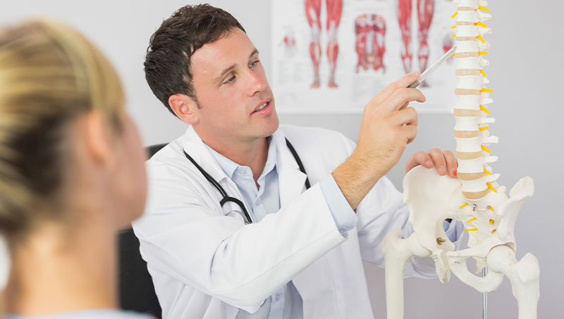 Chiropractor explaining treatment to new patient
