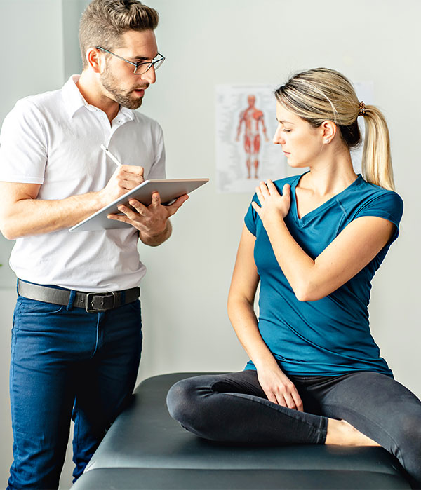 Patient consultation with chiropractor
