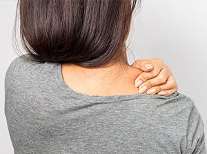 Woman suffering with shoulder pain