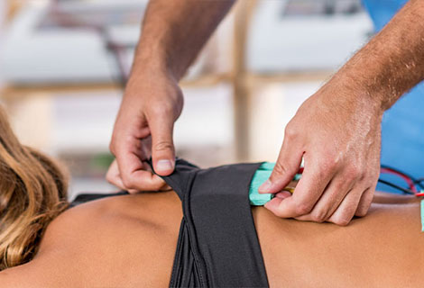Patient receiving electrical muscle stimulation therapy